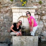 Mary & Karie washing their feet in the fountain (and embarrassing the boys)