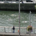 Group of crazy people swimming in the Liffey