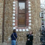 Karie and her mom trying to taste a building that reminds them of a gingerbread house