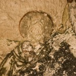 One of the many frescos with the eyes scratched out
