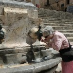 Aunt Janice taking a drink from a fountain in Tarragona, Spain